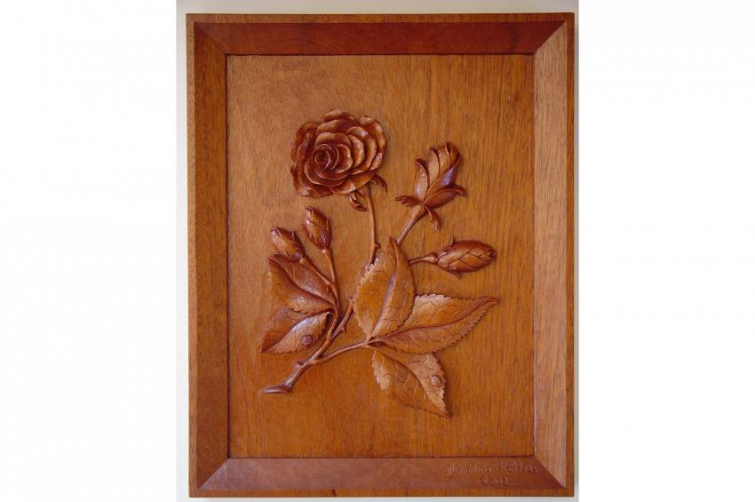 Mahogany rose relief with ladybugs